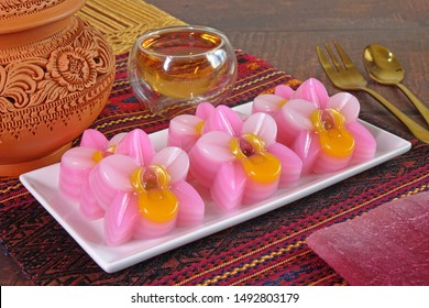 Thai dessert : Steamed layer sweet cake (or Khanom Chan) Thai traditional dessert in colorful orchid flowers shaped. One of nine famous Thai auspicious desserts in Thailand.