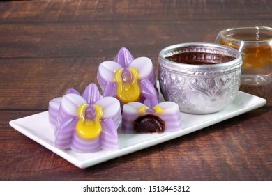 Thai dessert : Steamed layer sweet cake (or Khanom Chan) Thai traditional dessert in orchid flowers shaped, filling with red bean paste. One of nine famous Thai auspicious desserts in Thailand.