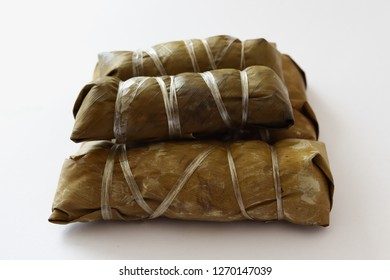 Thai dessert sticky rice with banana (Kao Tom Mad) isolated on white