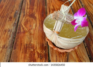Thai Eastern Style Sweet and Sour Cold Calamansi Citrus Juice Served on Wooden Table