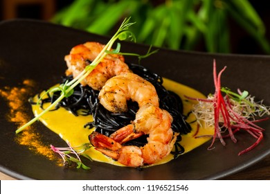 "Thai fine dining/ Fresh cilantro marinated ""Black Tiger"" shrimps and mango sauce on black noodles"