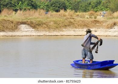Thai fishermen and boats.