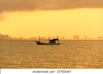 Thai fishermen is waiting on the boat, for fish , for life , for family