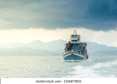 Thai fishing boat sailing sea background.