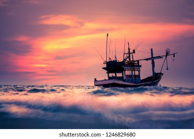 Thai fishing boat in the sea at sunset scene, Thailand.
