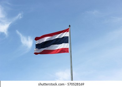 Thai flag with blue sky. Red white and blue flag.