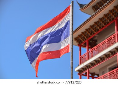 Thai flag in front of the old tower china landmark