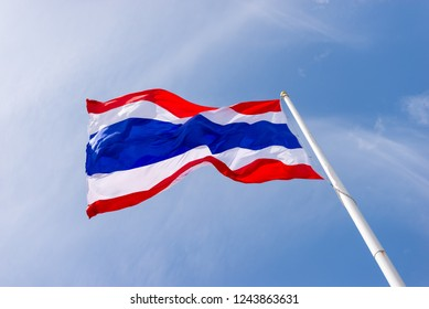 Thai flag waving with cloud and blue sky in background with copy space