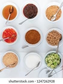 Thai flavouring sugar, fish sauce, vinegar, chilli powder, lemon, peanut