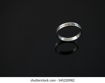 """Thai Font Laser Engraving """"To commemorate the royal of the 9th king of Thailand"""" on a ring on black background"""