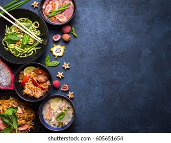 Thai food background. Dishes of thai cuisine. Tom yum, tom kha gai, pad thai noodles, fried rice with pork and vegetables khao phat mu, green papaya salad som tam, thai fruits. Space for text