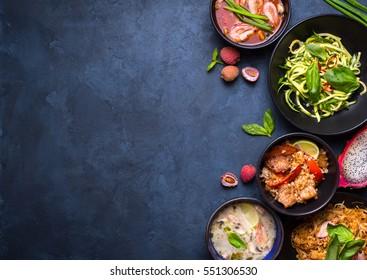 Thai food background. Dishes of Thailand cuisine. Tom yum, tom kha gai, pad thai noodles, thai fried rice with pork and vegetables khao phat mu, green papaya salad som tam, thai fruits. Space for text