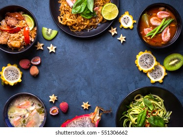 Thai food background. Dishes of Thailand cuisine. Tom yum, tom kha gai, pad thai noodles, thai fried rice with pork and vegetables khao phat mu, green papaya salad som tam, thai fruits. Space for text