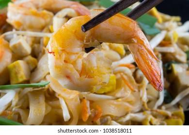 thai food called pad thai , with shrimp; selective focus.