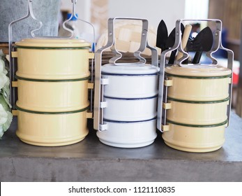 Thai food carrier/ Tiffin carrier or Pinto used for food on cement. Decorate restaurant or cafe.