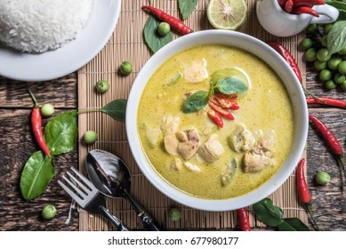 Thai food  chicken green curry on old wooden background, Top view.