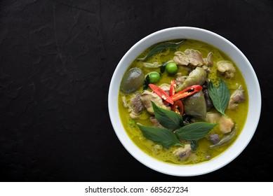 Thai food chicken green curry on dark background. top view