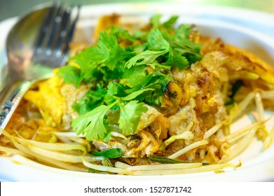 Thai food - Crispy oyster omelette in hot pan cooking, Oysters to fry with egg, Street food Bangkok. Thailand.