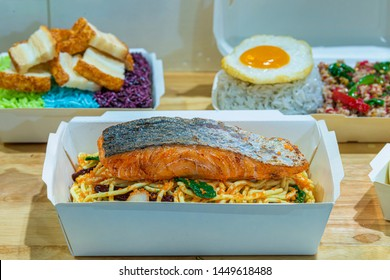 Thai Food Display in Restaurant. Fake Spaghetti Salmon grilled steak, Fake Crispy pork with three color rice, Fake stir-fried chicken and basil served with rice and fried egg. Selective Focus