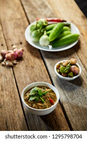 Thai food, Fermented fish spicy dip on wood, dark food photography