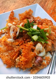"Thai food ""fried clam"" or accent in Thai ""hoi-tod"" Oysters, shrimp and squid mixed with crispy fried egg. Garnish with spring onion Eat with delicious sauce."