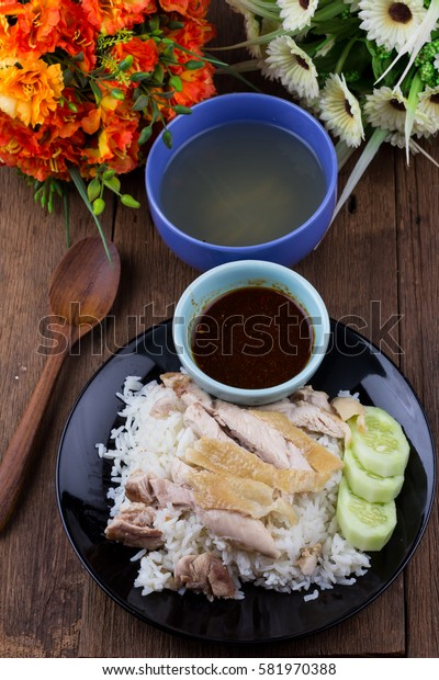 Thai food gourmet steamed chicken with rice , khao mun kai in wood background