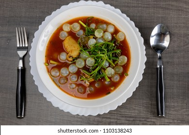Thai food hot and sour soup made of tamarind paste with giant catfish's eggs.