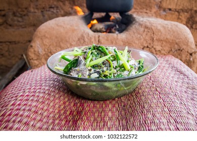 Thai food with mud stove background.