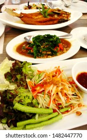 Thai food on table, Spicy salad and Fried fish