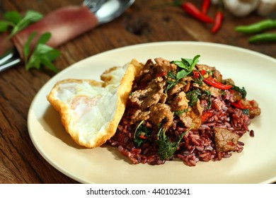 Thai food, Pad Ka Phrao, fried meat with chili, garlic and holy basil. eat with rice burry and fried egg.