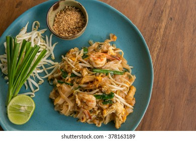 Thai food Pad thai , Stir fry noodles with shrimp on wooden table - asian cuisine