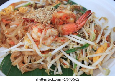 Thai food Pad thai , Stir fry noodles in padthai style , Thai style noodles with big shrimp famous steet food in Bangkok Thailand.