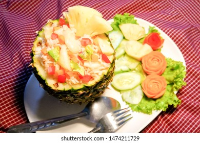 Thai food, Pineapple Fried Rice served inside of a pineapple, blur background.