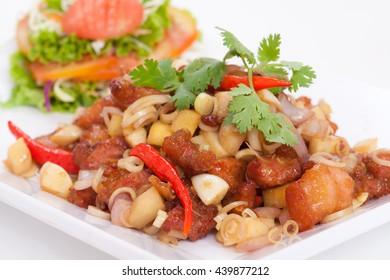 Thai food, pork fried herbs on white background.