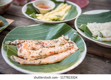 """Thai food recipe name is """"Khao parn pak"""", a egg steaming and topping with vegetable and roll with spicy sauce, This recipe from Sukhothai province at Thailand"""