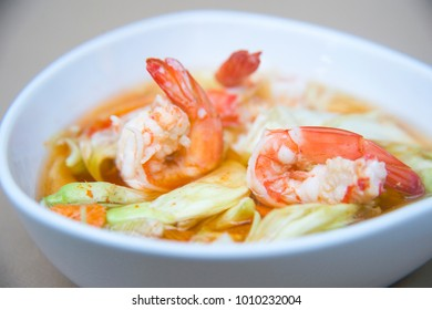 Thai food, Red curry with shrimp and Thai herb in white blow.