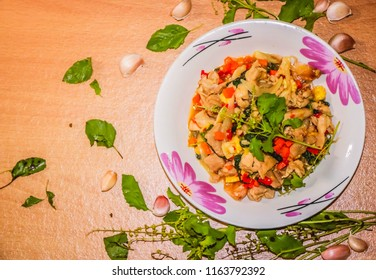 Thai food, Rice topped with fried chicken stir basil on wooden floor , background
