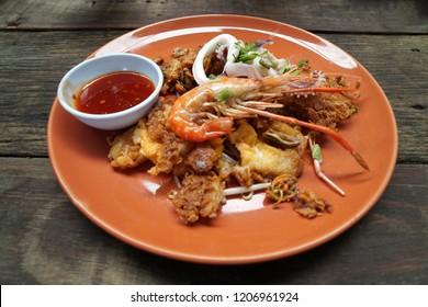 Thai Food Scene - Crisp Pan fried seafood - Mussels , shrimp , squid or thai call hoi tod