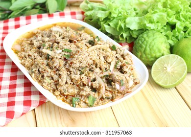 Thai food, spicy minced pork with chili and fresh vegetables