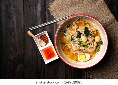 Thai food : Spicy noodle with pork and   egg (Noodle Tom yum moo)