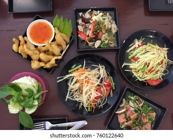 Thai food with spicy pork,papaya salad,spicy flavor.