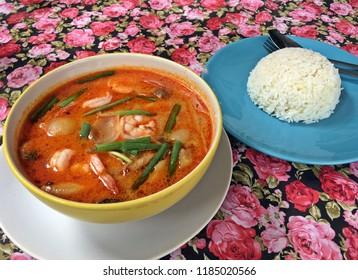 Thai food in Sukhothai (Thailand). Tomyam with prawns and boiled rice.