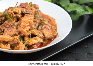 Thai food . Tasty Chicken or pork curry and spices with vegetables on wooden background . selective focus