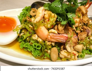 Thai Foods, Thai Cuisine closeup.  Yum Tua Poo, Spicy Wing Bean Shrimp Salad with Boiled Egg on background.