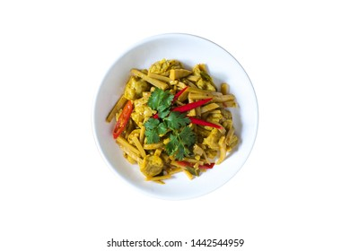 Thai food,Spicy fried clown featherback  fishball with Bamboo Shoots in a white dish isolated on white background with clipping path.Top view.