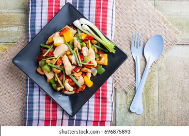 Thai food,stir fired chicken with cashew nuts on rustic wooden background