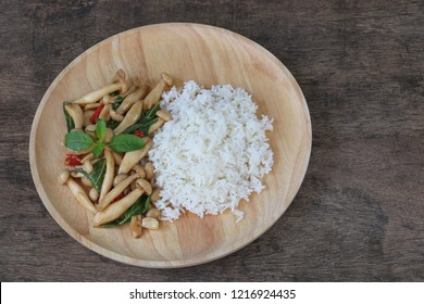 Thai food,stir fried shimeji mushroom with basil and steamed rice.This popular Thai dish.