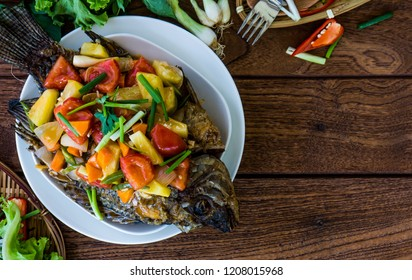 Thai Fried Fish and Topped with Fried Stir Sweet and Sour: To make sweet and sour sauce – In the wok mix vinegar, sugar, fish sauce, onion, pineapple, tomato and ketchup.