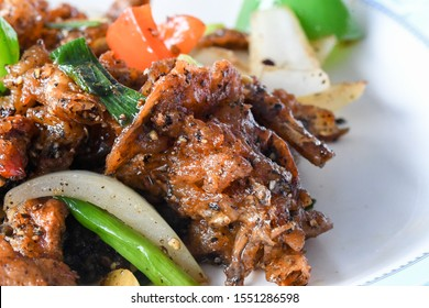 Thai Fried soft shell crab with black pepper in Thai restaurant - closeup shot with macro lens