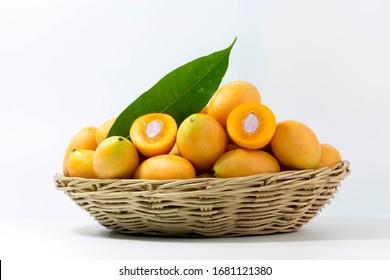 thai fruit Mayongchid Maprang Marian in basket on white background